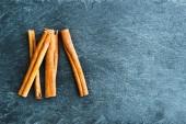 Closeup on cinnamon sticks on stone substrate — Stock Photo