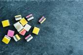 Closeup on liquorice candies on stone substrate — Stock Photo