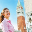 Happy young woman against campanile di san marco in venice, ital — Stock Photo #60612083