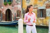 Happy young woman with map in venice, italy — Stock Photo