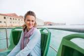 Portrait of young woman travel by venice water bus — Stock Photo