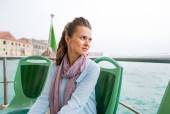 Portrait of young woman travel by venice water bus and looking o — Stock Photo