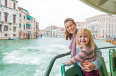 Happy mother and baby girl travel by venice water bus — Stock Photo