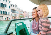 Mother and baby girl travel by venice water bus — Stock Photo