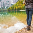 Closeup on young woman walking on lake braies in south tyrol, it — Stock Photo #61200861