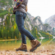 Closeup on young woman walking on lake braies in south tyrol, it — Stock Photo #61200879