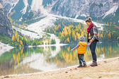 Mother and baby having fun time on lake braies in south tyrol, i — Stock Photo