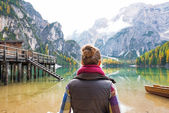 Young woman on lake braies in south tyrol, italy. rear view — Stock Photo