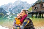 Happy mother and baby on lake braies in south tyrol, italy looki — Stock Photo
