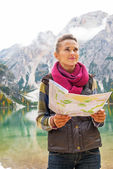 Young woman with map on lake braies in south tyrol, italy — Stock Photo