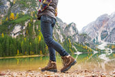 Closeup on young woman walking on lake braies in south tyrol, it — Stock Photo