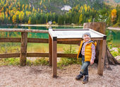 Portrait of baby near information board while on lake braies in  — Stock Photo