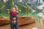 Portrait of relaxed young woman on lake braies in south tyrol, i — Stock Photo