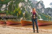 Full length portrait of young woman on lake braies in south tyro — Stock Photo