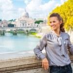 Portrait of happy young woman on bridge ponte umberto I with vie — Stock Photo #64003361