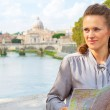 Happy young woman with map on bridge ponte umberto I with view o — Stock Photo #64003407