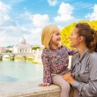 Happy mother and baby girl on bridge ponte umberto I with view o — Stock Photo #64003439