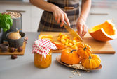 Closeup on young housewife cutting pumpkin for pickling — Stock Photo