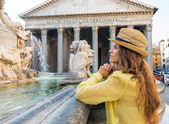 Portrait of thoughtful young woman near fountain of the pantheon — Stock Photo