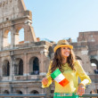 Happy young woman with italian flag in front of colosseum in rom — Stock Photo #65070357