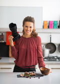 Portrait of smiling female food photographer in kitchen — Stock Photo