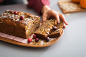 Young housewife taking piece of freshly baked pumpkin bread — Stock Photo