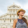 Happy young woman in front of duomo di pisa, pisa, tuscany, ital — Stock Photo #65834155
