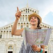 Happy young woman with map pointing in front of duomo di pisa, p — Stock Photo #65834177