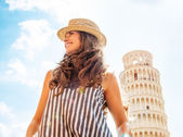 Portrait of happy young woman looking into distance in front of — Stock Photo