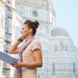 Woman with audio guide standing — Stock Photo #67065635