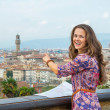 Young woman with map pointing on panoramic view of florence — Stock Photo #68372517