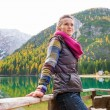 Woman hiker rests, facing away from Lake Bries — Stock Photo #72465641