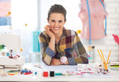 Portrait of happy dressmaker woman in studio — Stock Photo
