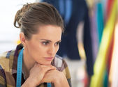 Portrait of stressed tailor woman at work — Stock Photo