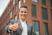 Portrait of happy business woman stretching hand for handshake i — Stock Photo