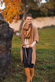 Happy young woman in autumn outdoors in evening — Stock Photo