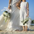 Bride and Flower Girl on Beach — Stock Photo #60147295