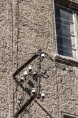 Metal frame and insulators on wall — Stock Photo