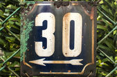 Weathered enameled plate number 30 — Stock Photo