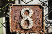 Old retro cast iron plate number 8 — Stock Photo