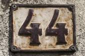 Old retro cast iron plate number 44 — Stock Photo