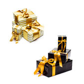 Gift boxes with yellow ribbon — Стоковое фото