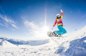 Girl having fun on her snowboard — Stock Photo