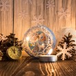 Christmas tree decorations and candles on an old wooden backgrou — Stock Photo #59770177