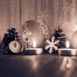 Christmas tree decorations and candles on an old wooden backgrou — Stock Photo #59770235