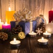 Christmas tree decorations and candles on an old wooden backgrou — Stock Photo #59771721
