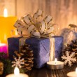 Christmas tree decorations and candles on an old wooden backgrou — Stock Photo #59772407