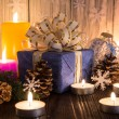 Christmas tree decorations and candles on an old wooden backgrou — Stock Photo #59772461