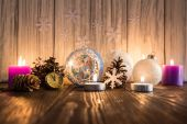 Christmas tree decorations and candles on an old wooden backgrou — Foto de Stock