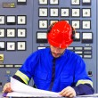 Engineer working in the industrial interior — Stock Photo #79265196